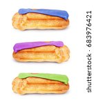 Small photo of couple of delicious french pastry eclair eclaire covered with raspberry top isolated on white