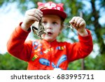 the little boy in the red shirt ... | Shutterstock . vector #683995711