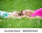mother and daughter playing in... | Shutterstock . vector #684002464