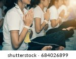 Small photo of Students are reciting mantras to share merit. for the peace of mind.To practice mindfulness.It is a practice for Buddhists.