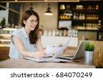 happy asia woman using laptop... | Shutterstock . vector #684070249