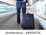 traveller on the speedwalk | Shutterstock . vector #68409124
