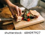 man prepares lunch  serves... | Shutterstock . vector #684097927