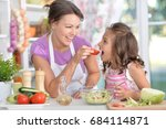 mother and daughter preparing... | Shutterstock . vector #684114871