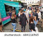 Small photo of TARNOWSKIE GORY, POLAND - JULY 16, 2017: People eat at a food truck event in Tarnowskie Gory, Poland. Food truck culture has been gaining momentum all over Europe in recent years.
