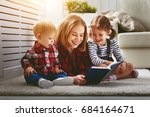 Small photo of Mother reads book to children son and daughter