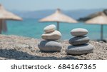 two pebble towers with sun... | Shutterstock . vector #684167365