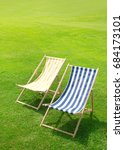 two deck chairs on the lawn | Shutterstock . vector #684173101