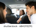 group of happy friends on a car | Shutterstock . vector #684193291
