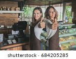 two excited waitress showing... | Shutterstock . vector #684205285