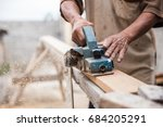 close up of a worker grinds the ... | Shutterstock . vector #684205291