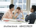 the designers seriously discuss. | Shutterstock . vector #684219829