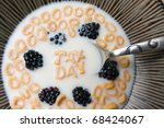 The words TAX DAY spelled out of letter shaped cereal pieces floating in a milk filled cereal bowl. - stock photo