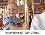 child having fun on the merry... | Shutterstock . vector #68424559