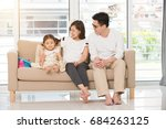 asian family on sofa | Shutterstock . vector #684263125