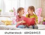 two cute children girls reading ...   Shutterstock . vector #684264415