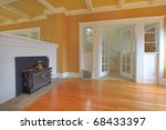 Yellow warm living room with antique fireplace and white molding. - stock photo