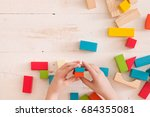 top view on child's hands... | Shutterstock . vector #684355081