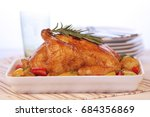 roasted chicken  blurry plates... | Shutterstock . vector #684356869