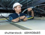 electrician fitting a cable for ... | Shutterstock . vector #684408685