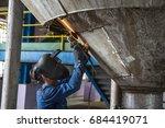worker grinding repair... | Shutterstock . vector #684419071