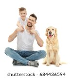 Stock photo father and son with dog on white background 684436594