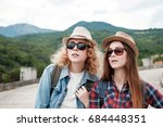 two girls in hats traveling... | Shutterstock . vector #684448351