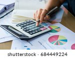 woman hand using calculator and ... | Shutterstock . vector #684449224