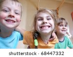 three happy kids playing... | Shutterstock . vector #68447332