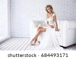 beautiful young bride in white... | Shutterstock . vector #684493171