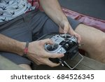 two male hands holding a remote ... | Shutterstock . vector #684526345
