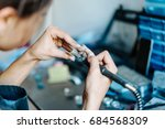 the girl works on a jewelry in... | Shutterstock . vector #684568309