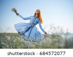 woman in a chamomile field and ... | Shutterstock . vector #684572077