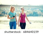 two young women are walking on... | Shutterstock . vector #684640159