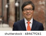 asian businessman in suit smile ... | Shutterstock . vector #684679261