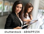 two business woman check report ... | Shutterstock . vector #684699154