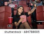 pretty girl taking a selfie... | Shutterstock . vector #684788005