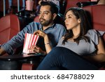 good looking couple watching a... | Shutterstock . vector #684788029