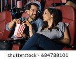 happy hispanic couple watching... | Shutterstock . vector #684788101