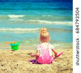baby girl playing in the sand... | Shutterstock . vector #684793504