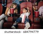kid sitting in the cinema... | Shutterstock . vector #684794779