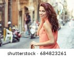 beautiful woman walking down... | Shutterstock . vector #684823261