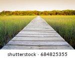 long wooden walkway with... | Shutterstock . vector #684825355