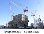 Small photo of AUCKLAND - JULY 26 2017:Four cranes in a building site.A record 132 cranes are operating in cities around New Zealand.The construction boom is mostly in residential and commercial jobs in Auckland CBD