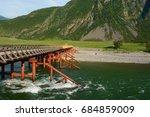 bridge. bashkaus river flows... | Shutterstock . vector #684859009