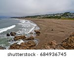 people on the beach  cloudy sky ...   Shutterstock . vector #684936745
