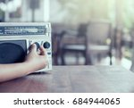 woman hand adjusting the sound... | Shutterstock . vector #684944065