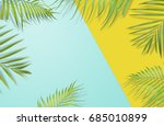 Tropical Palm Leaves On Yellow...