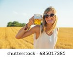 happy girl holding beer glass... | Shutterstock . vector #685017385