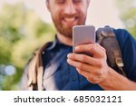 a man holds silver smart phone. ... | Shutterstock . vector #685032121